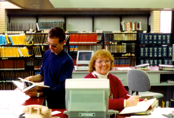 Tom Acra and librarian Brenda Hill, January 1993. (Photo: Richard Friend)